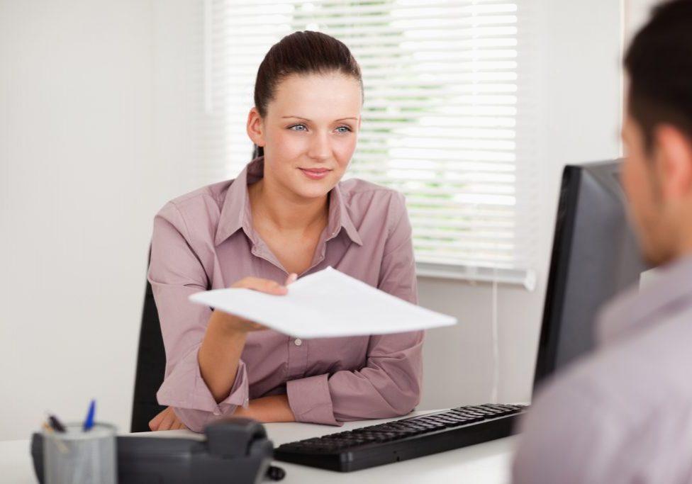 girl handling the paper